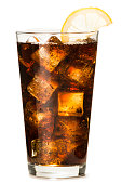 Pint glass of sparkling cola soda soft drink isolated on white background with lemon slice and ice cubes