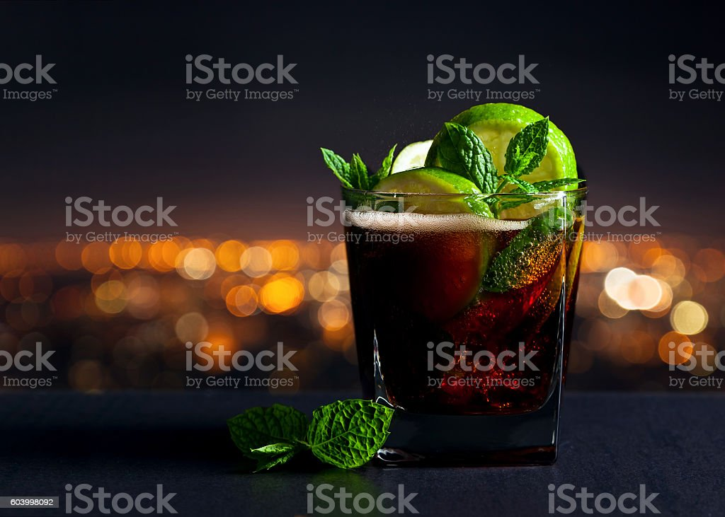 Cola with lime , ice  and peppermint stock photo