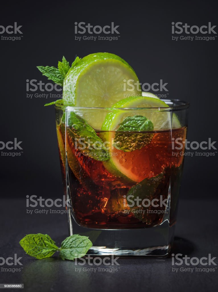 Cola with rum , lime  and mint . stock photo