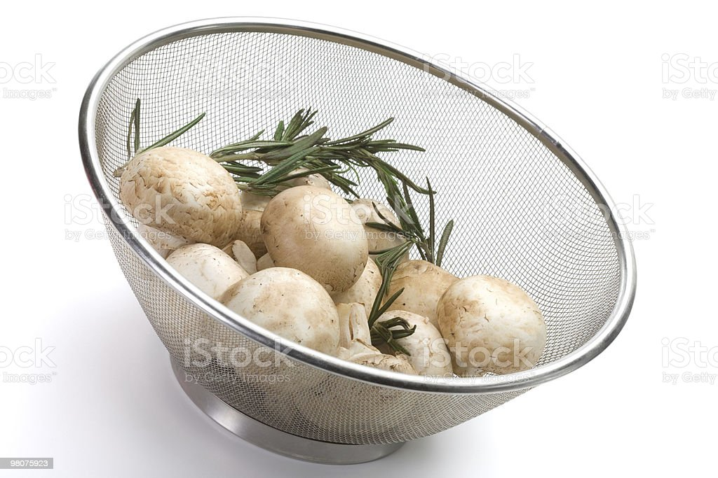 Colander of fresh-cut mushrooms champignon royalty-free stock photo