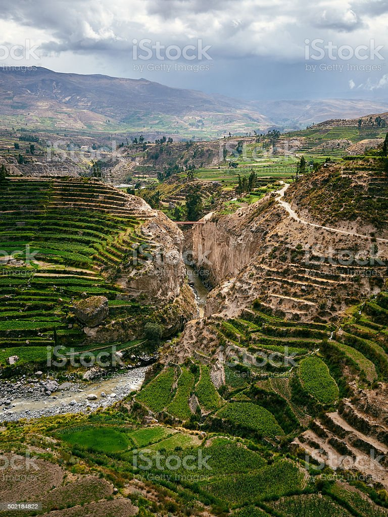 Colca Canyon in Peru with dark clouds stock photo