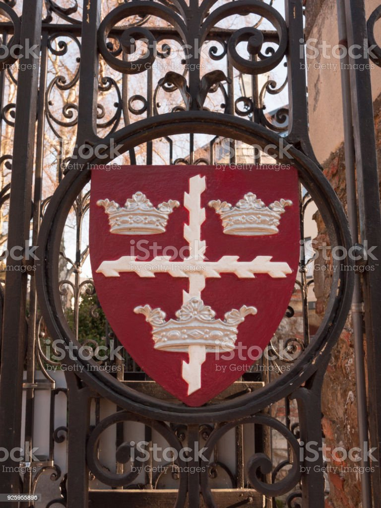 colchester shield sign emblem on gates red and black town park stock photo