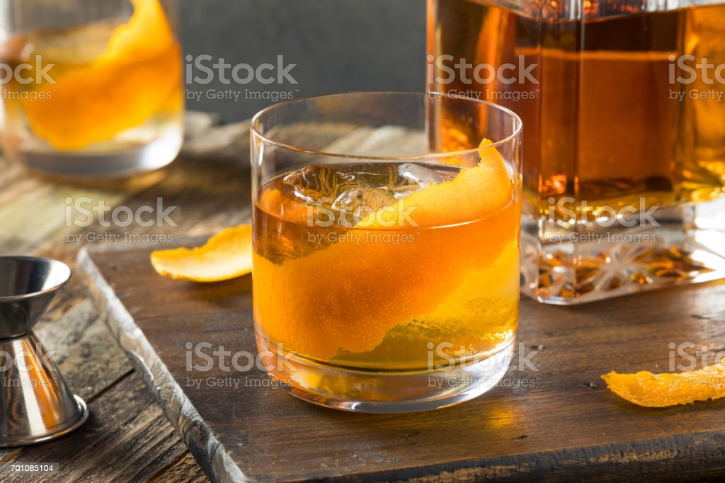 Cold Alcoholic Old Fashioned Bourbon Whiskey Cocktail stock photo