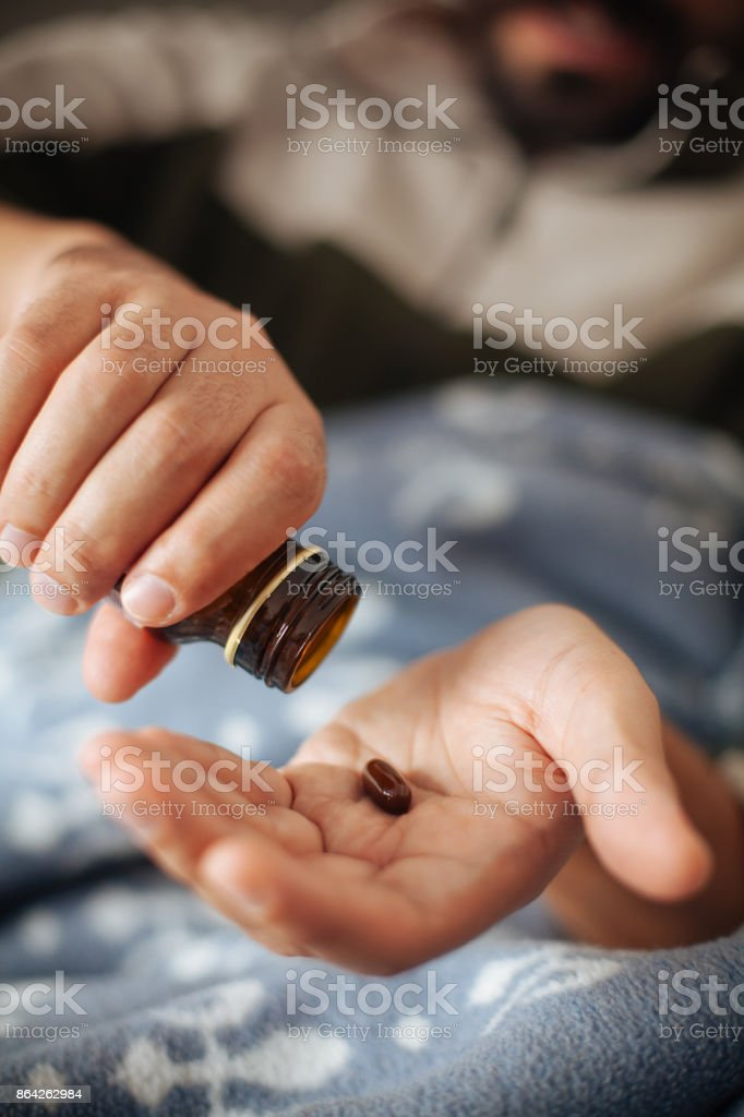 Cold and flu man taking pill royalty-free stock photo