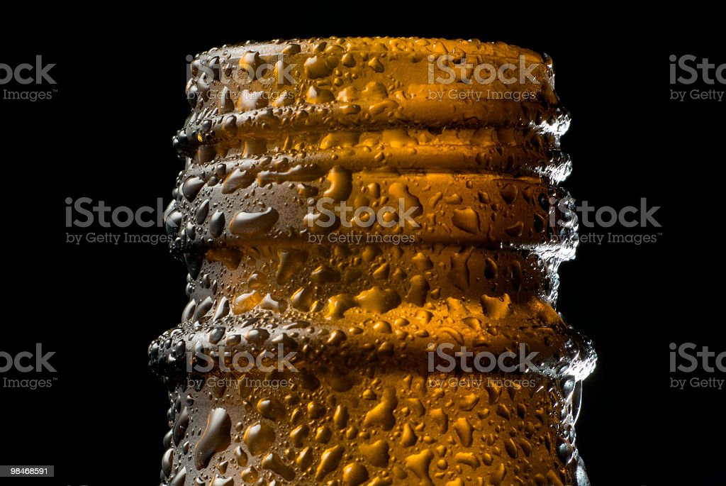 Cold Beer bottle top macro royalty-free stock photo