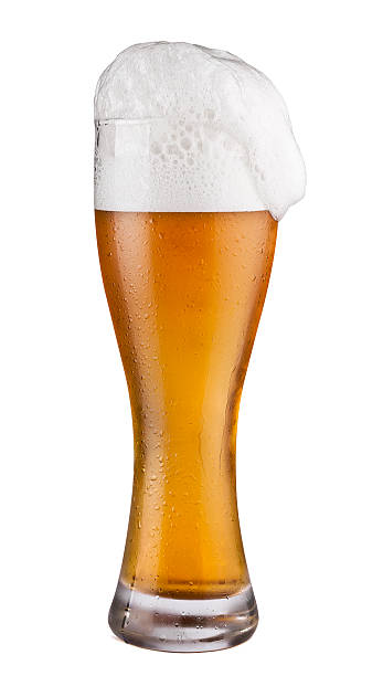 cold beer glass isolated on white - beer foam stock photos and pictures
