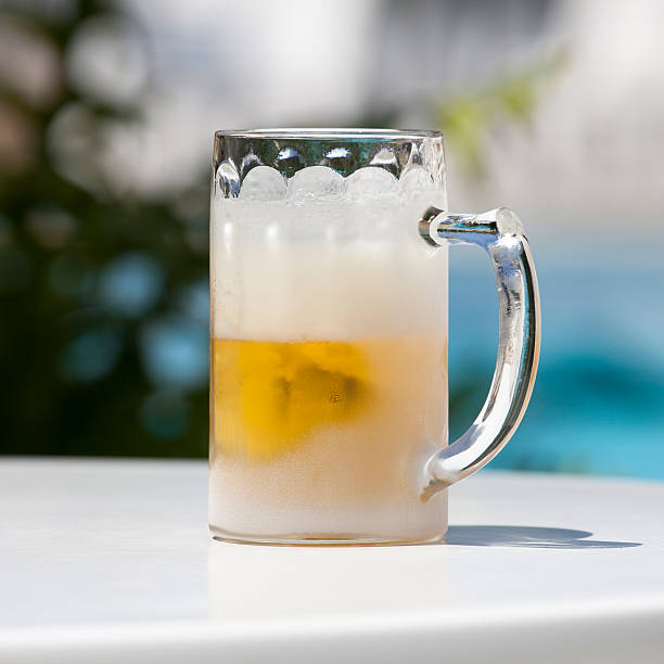 Cold Beer in an Iced Glass with Clipping Path stock photo