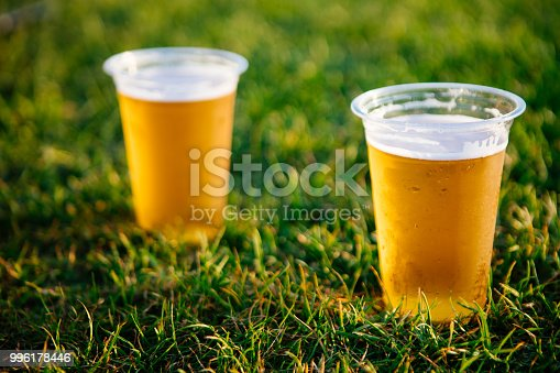 istock Cold beer on grass 996178446