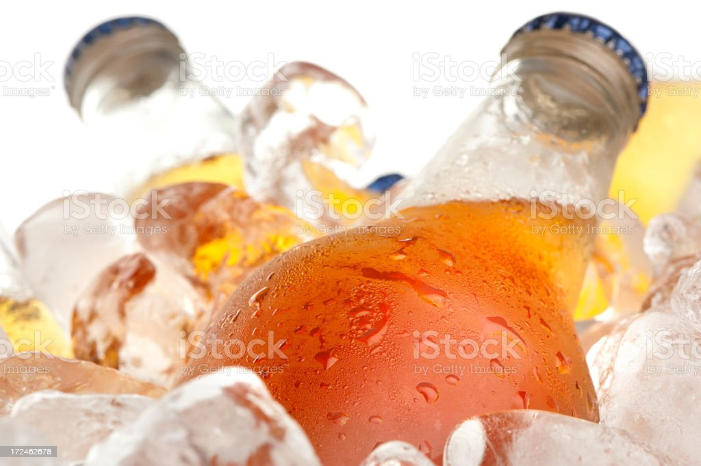 Cold beer on ice stock photo