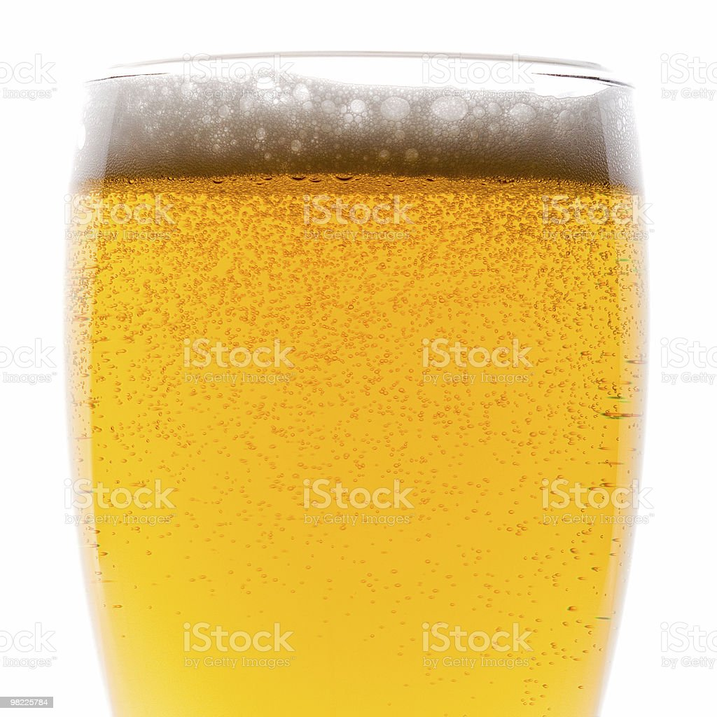 Cold beer with froth royalty-free stock photo