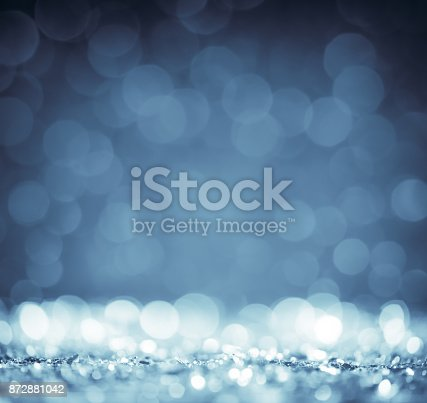 872229066 istock photo Cold blue defocused glitter background 872881042