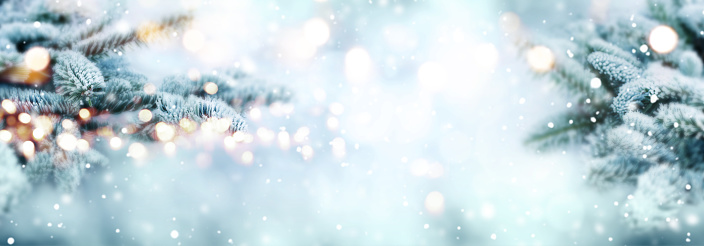 Cold blue snowy winter scenery with bright bokeh for a christmas decoration