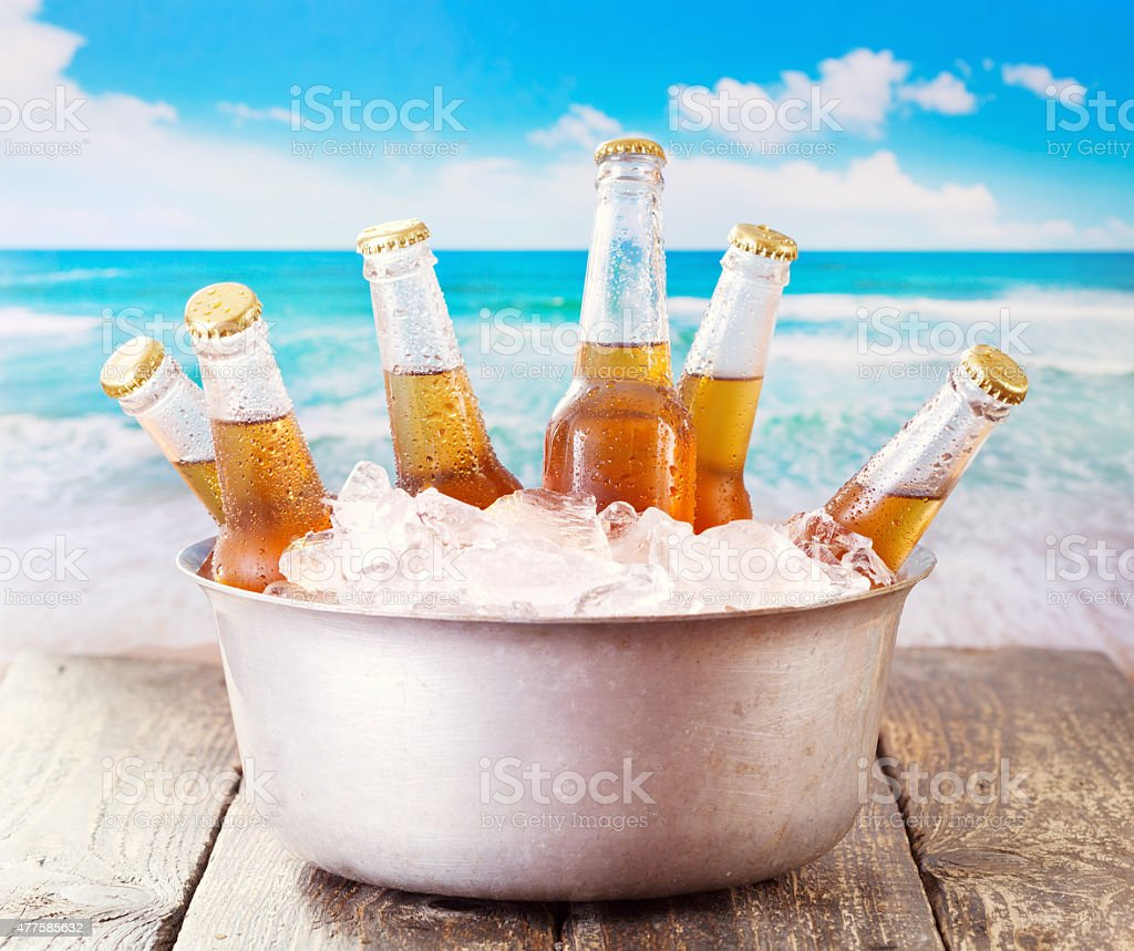 cold bottles of beer in bucket with ice stock photo