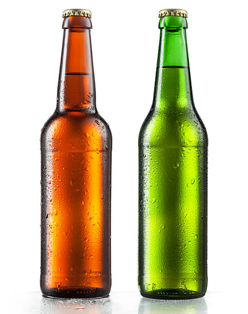 cold bottles of beer on a white background - dark beer stock photos and pictures