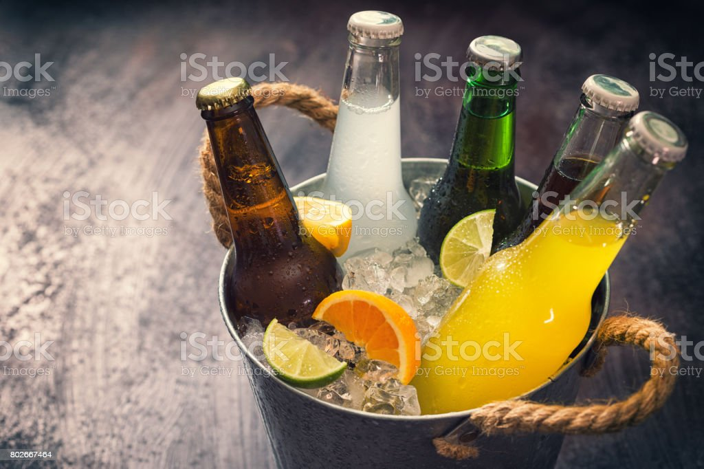 Cold Bottles of Various Drinks in The Ice Bucket stock photo