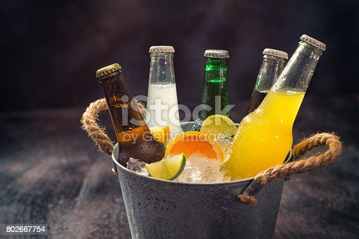 istock Cold Bottles of Various Drinks in The Ice Bucket 802667754