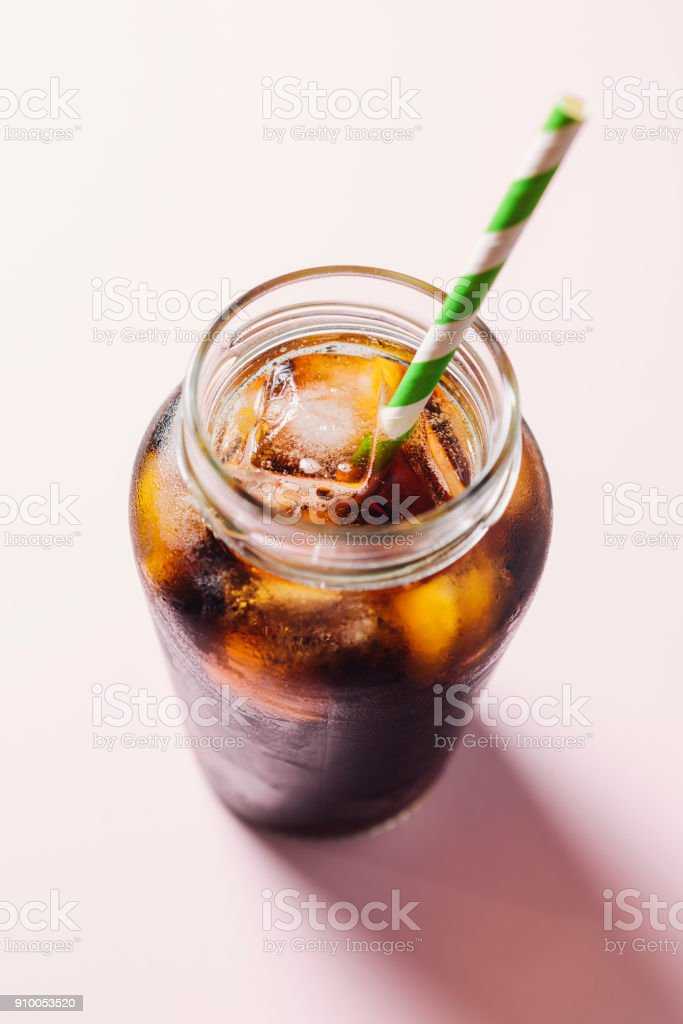 Cold brew coffee against a pink background. stock photo