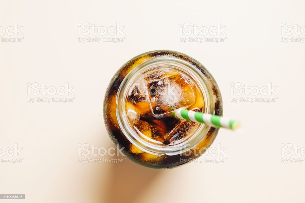 Cold brew coffee against a yellow background. stock photo
