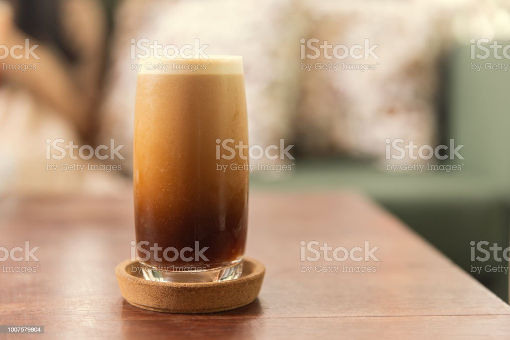 Cold brew or Nitro Coffee drink in the glass with bubble foam stock photo