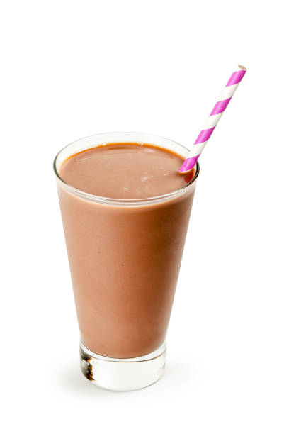 cold chocolate milk glass of cold chocolate milk with straw isolated on white chocolate milk stock pictures, royalty-free photos & images