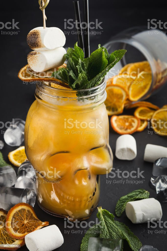 Cold cocktail in skull glass on black background royalty-free stock photo
