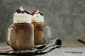 istock Cold coffee drink in glass jar 519657982