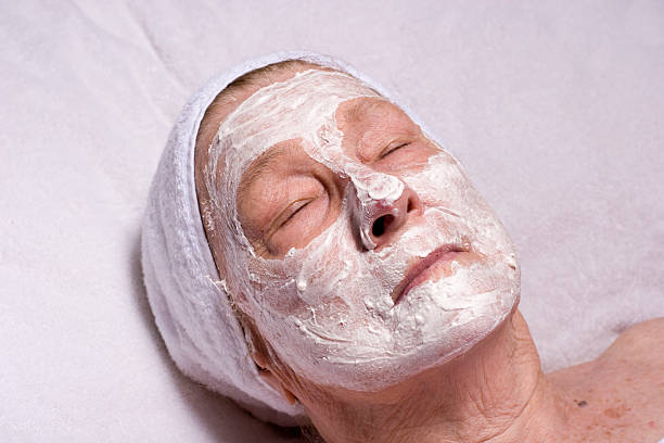 Cold cream on face stock photo