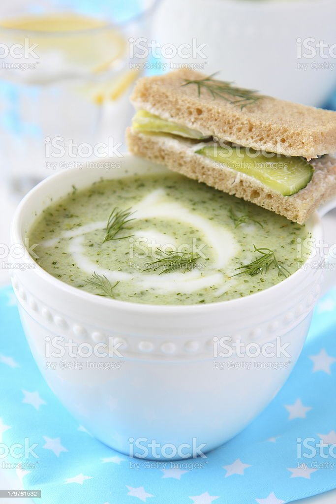 Cold cucumber-yogurt soup with dill, and cucumber sandwich royalty-free stock photo