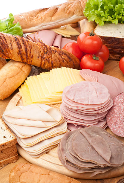 Cold cuts and bread for sandwiches stock photo