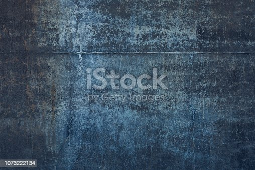 A cold temperatured low key weathered wall background.