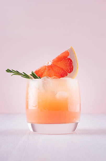 Cold detox cocktail of grapefruit juice with ice rosemary slices on picture id975705080?b=1&k=6&m=975705080&s=612x612&w=0&h=waat0uu9vbll8l0seffurlnbcrdltb4lonvoiec2efa=