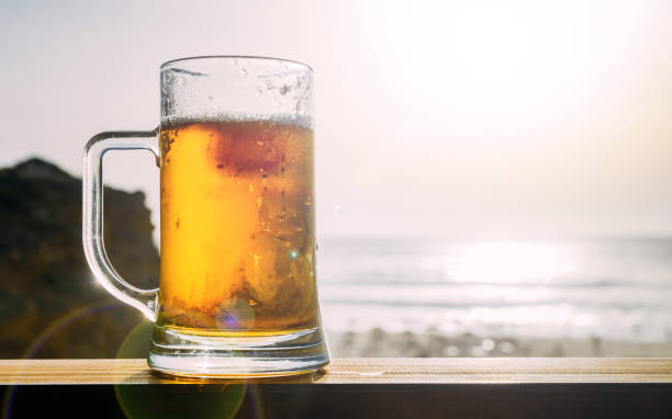 Cold draft beer at beach stock photo