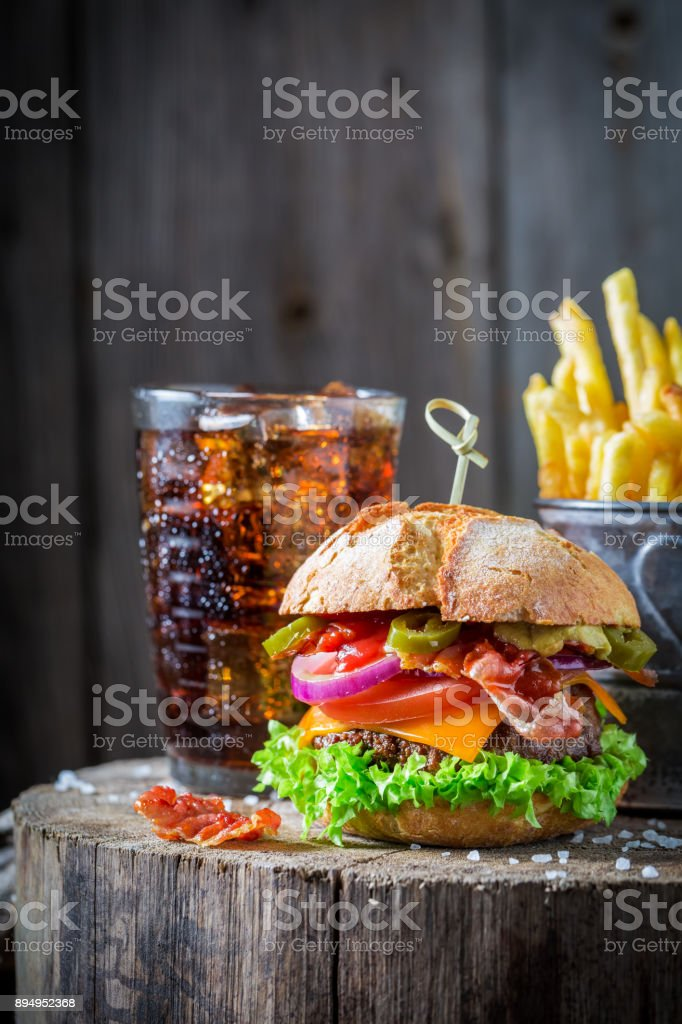 Cold drink and tasty hamburger made of vegetables, beef stock photo