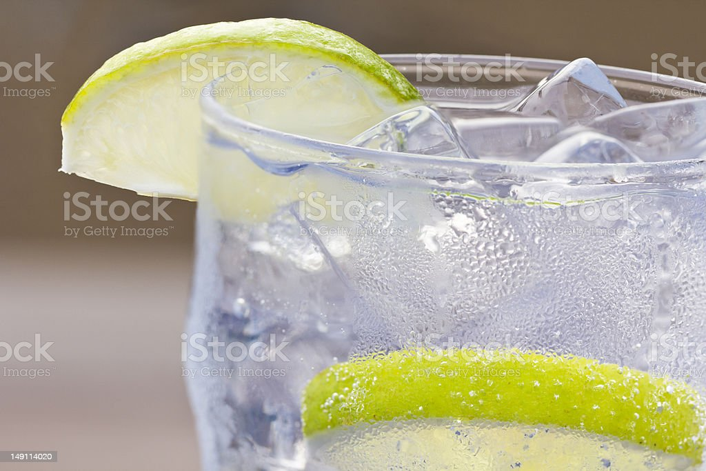 Cold Drink with Lime Slices stock photo