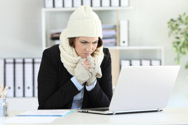 Cold executive working with a heater failure in winter stock photo