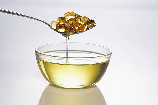 cold fish oil - cod liver oil stock photos and pictures