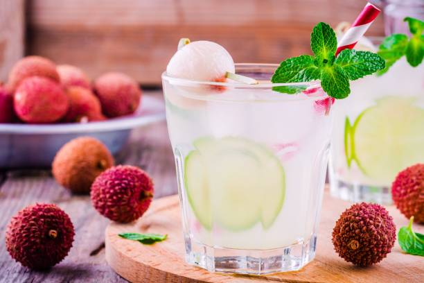 Cold fresh lemonade with lychee, lime and mint in glass stock photo