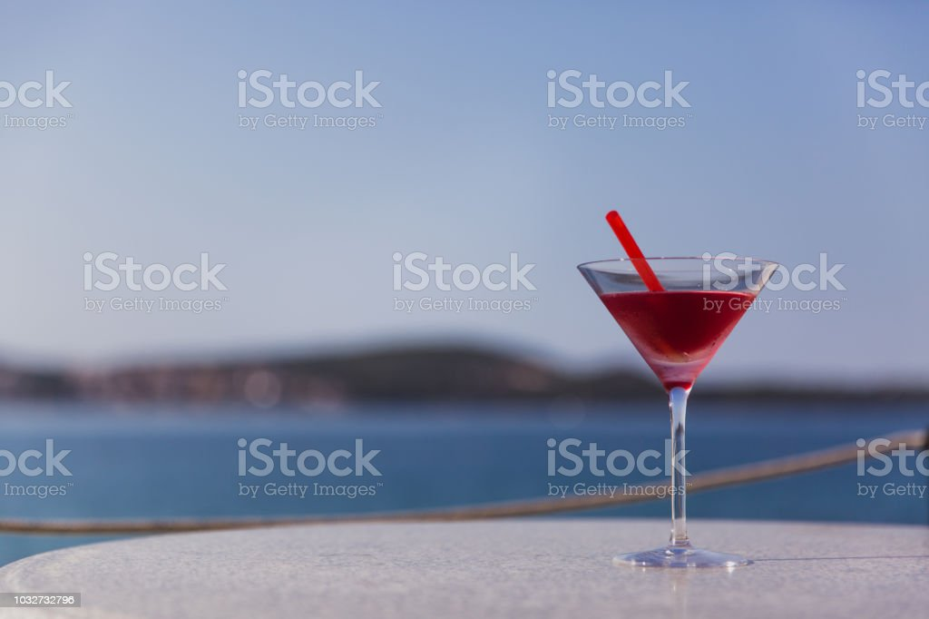 Cold glass of aperol spritz appetizer stand on table near the river stock photo