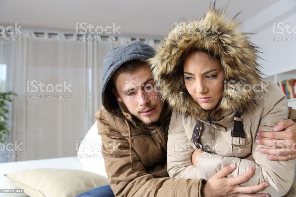 Cold home with an angry couple stock photo