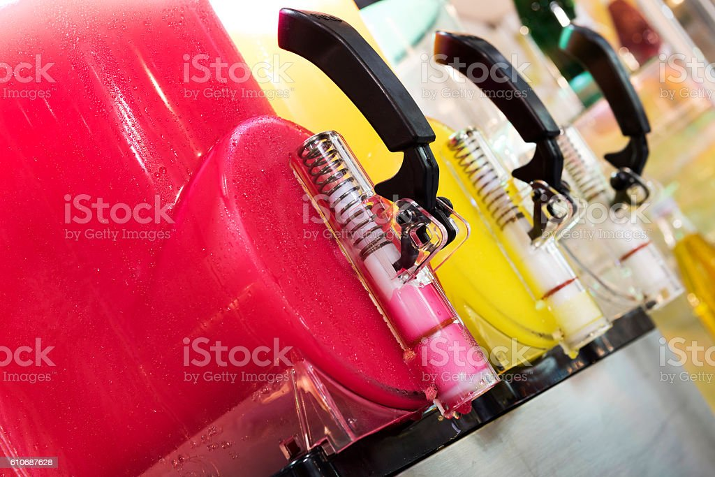 Cold ice slush fruit juice beverage equipment machine stock photo