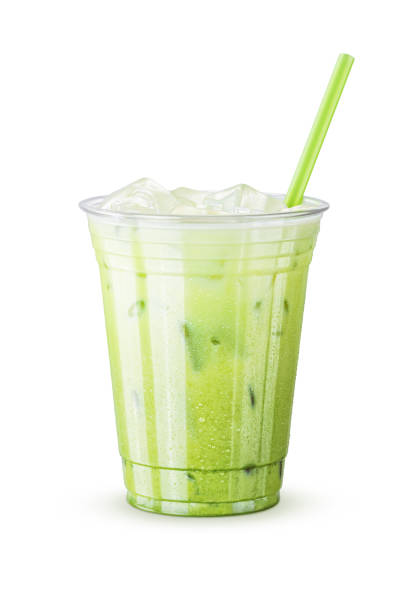Cold Iced Green Tea (Matcha) Latte with Straw on White Background stock photo