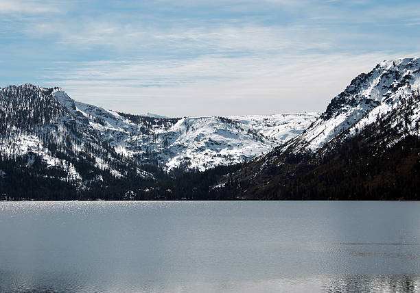 Cold Lake and Snowy Mountains stock photo
