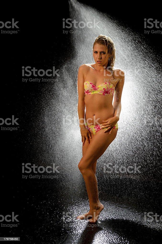 Cold looking bikini model full length. royalty-free stock photo