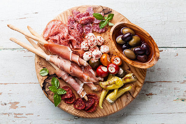 Cold meat plate and bread sticks stock photo