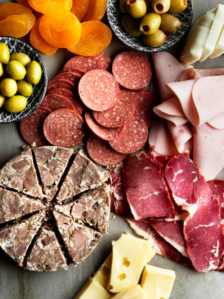 Cold meat plate, charcuterie, Salami and pastrami, Cold smoked meat platter snacks set, ham and meat delicatessen, Assortment of salami and snacks, tapas, stock photo