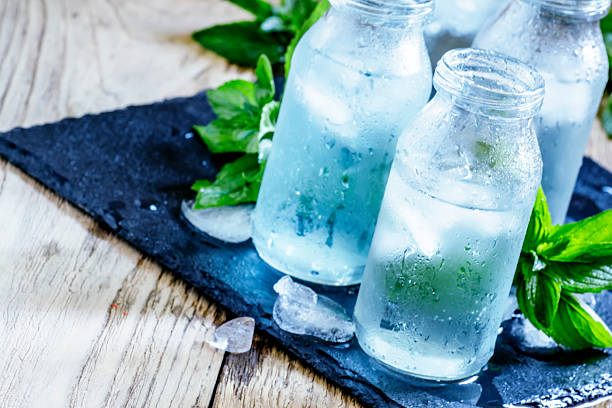 cold mineral water with ice - drinking water stock photos and pictures