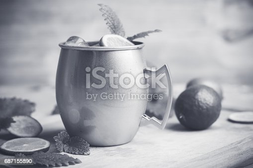 istock Cold Moscow Mule cocktail in copper mug on the rustic background 687155890