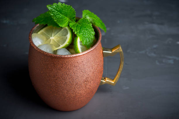 cold moscow mule cocktail in copper mug on the rustic background - muli stock-fotos und bilder