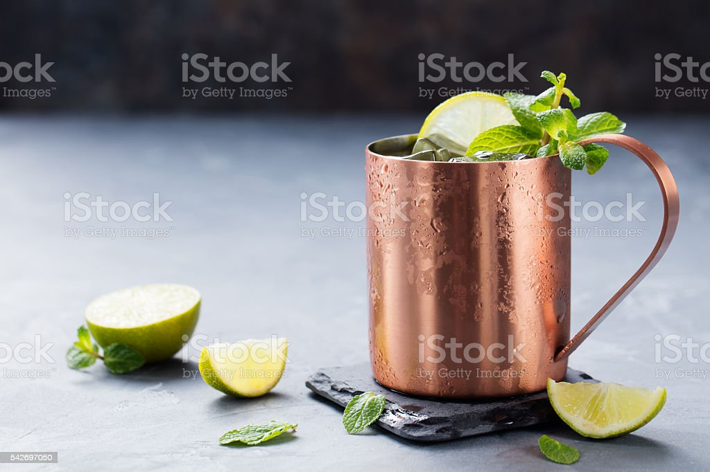 Cold Moscow Mules cocktail with ginger beer, vodka, lime stock photo