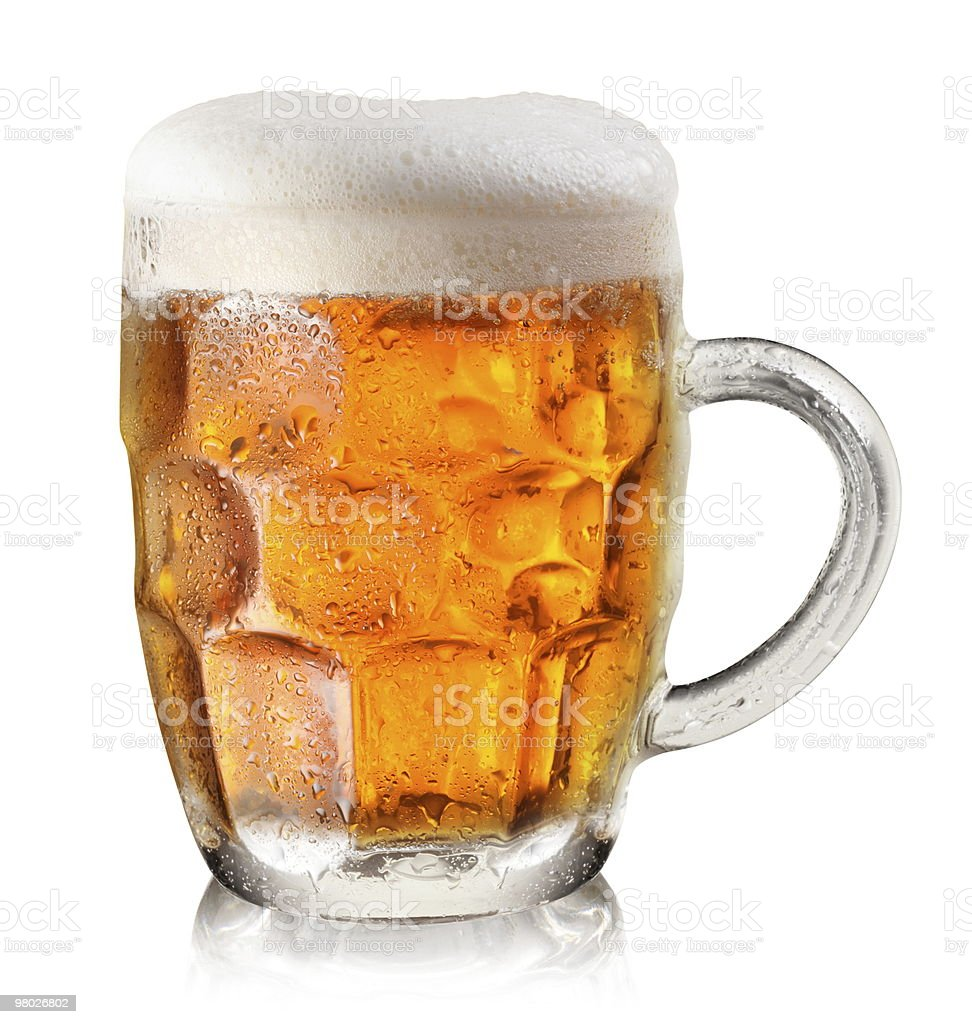 Cold mug of beer with foam on top on a white background royalty-free stock photo